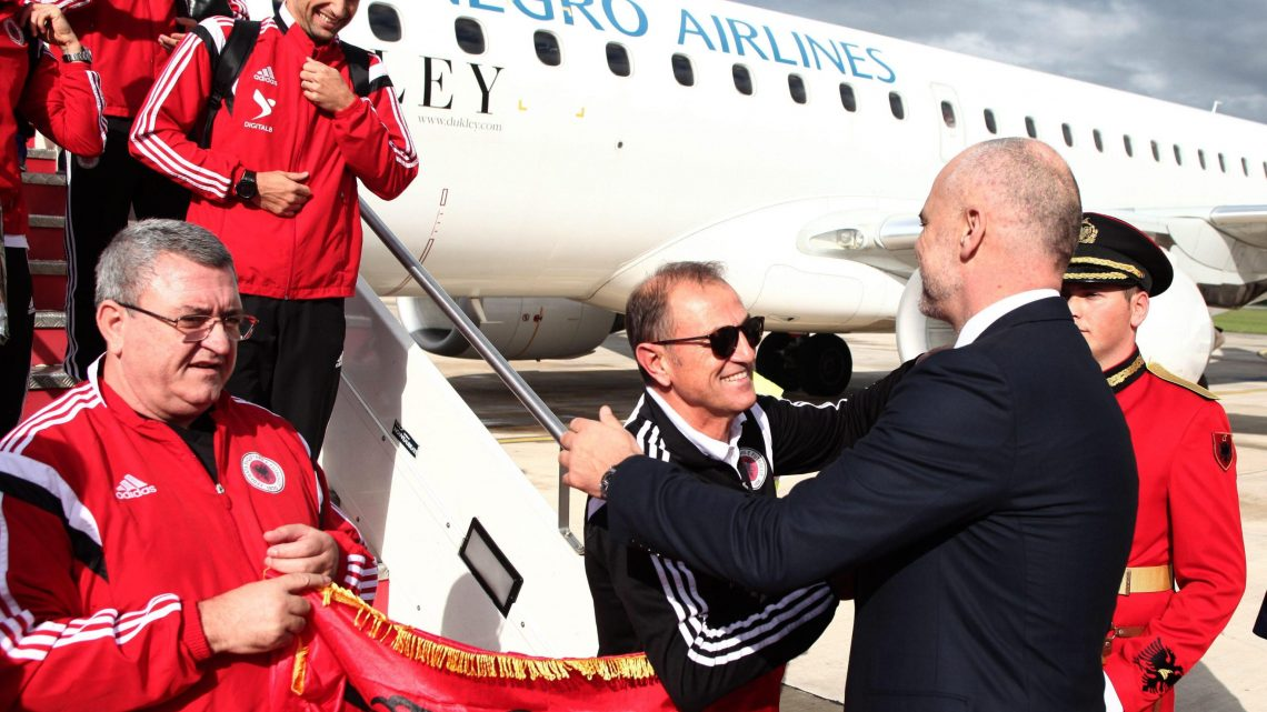 epa04975142 Albanian Prime Minister Edi Rama (R) welcomes Albanian Head Coach Giovanni De Biasi (C) and Albanian Soccer Federation President Armand Duka (L) as the Albanian national soccer team arrives in Tirana, Albania, 12 October 2015. Thousands of Albanians turned out in the capital Tirana to welcome the national football team after it secured the country's first-ever place at a major finals. Albania the previous day secured second spot in Euro 2016 qualifying Group I with a 3-0 win away to Armenia.  EPA/ARMANDO BABANI