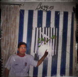 Year 2006: In my unwashed England shirt , posing in front of the wall I had painted