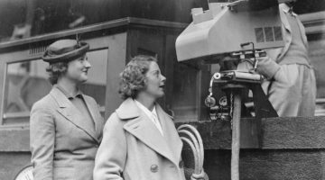 The American tennis stars, Miss Alice Marble and Miss Kathryn Winthrop, look at the BBC camera installed on Centre Court for the first time at the Wimbledon Championhips, held at The All England Lawn Tennis Club in 1937.
